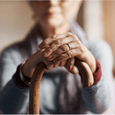 Aging women holding cane